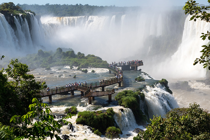 People exploring Iguazu Falls