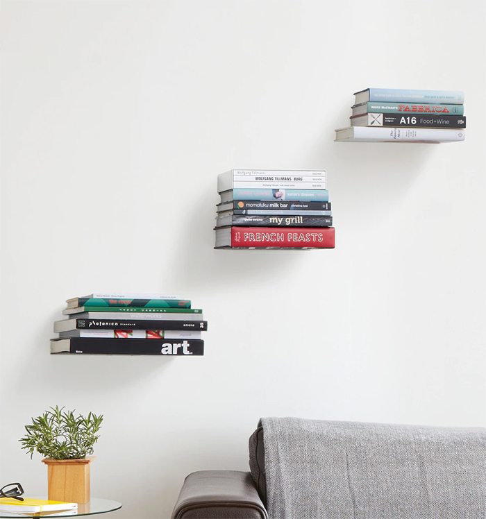 Invisible  wall bookshelves above the couch