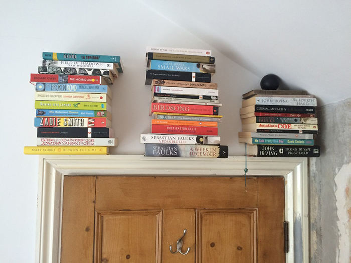 Invisible bookshelves above the door