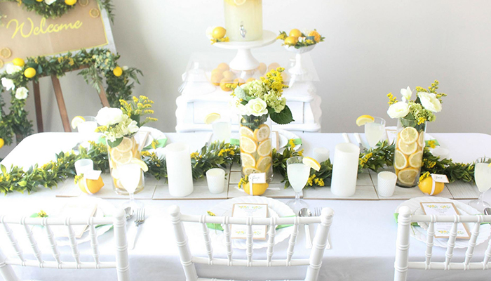 Lemon and flowers filled vases as a wedding table decor