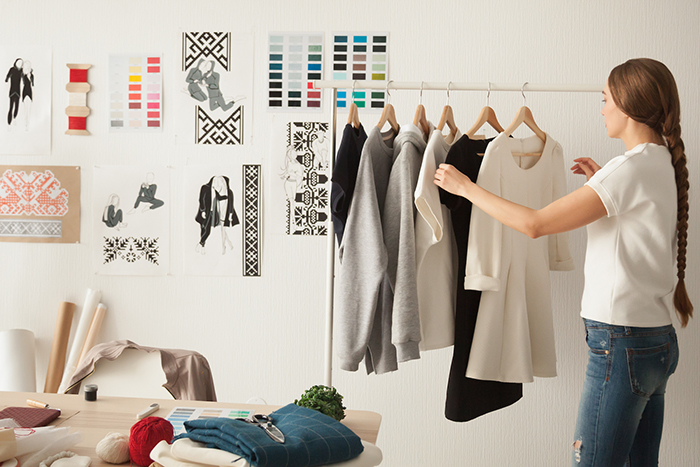 Woman arranging her clothes on a hanger