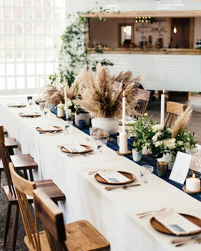 Pampas grass, candles and flowers on the wedding table