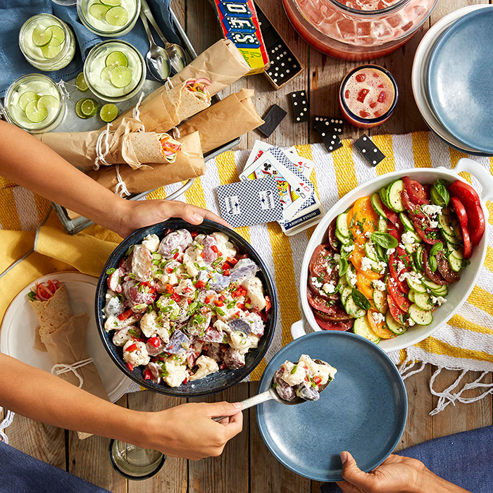 Different kinds of picnic food and board games
