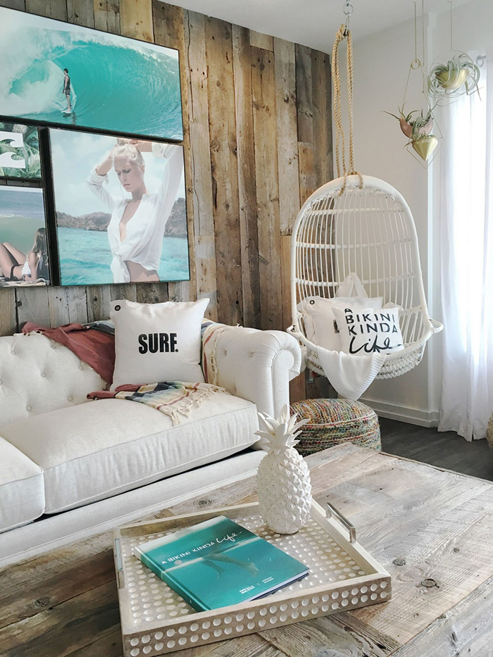 Rustic coastal living room with picture hanging on a wooden wall