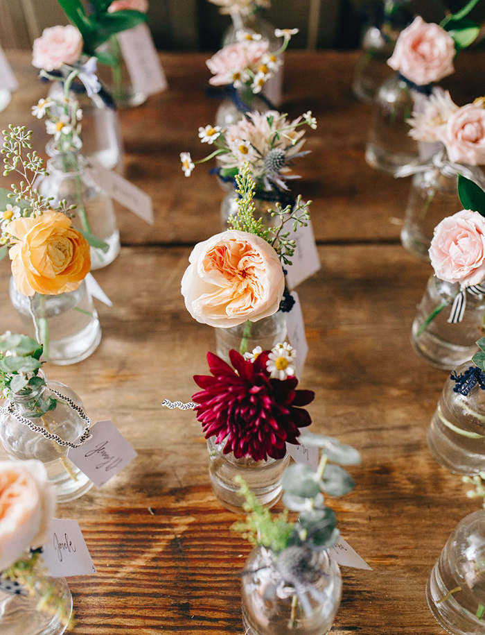 Summer wedding look with flowers put in bottles