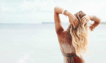 Woman on the beach with long blonde hair