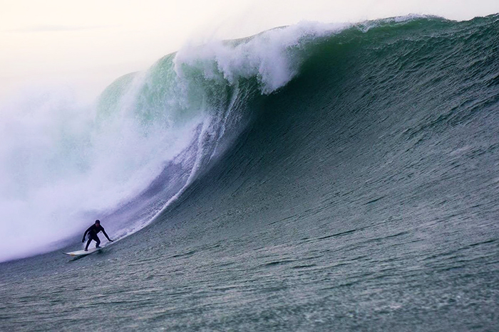 Man surfing on the waves in Ireland