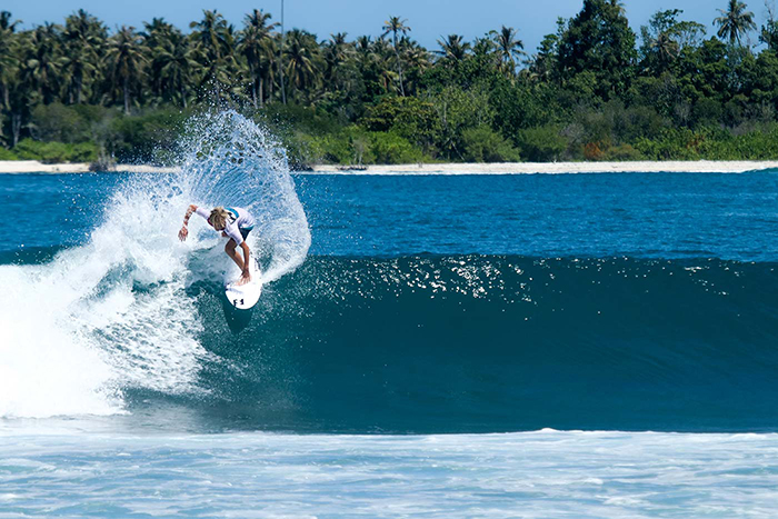 Woman surfing at Mentawai Islands