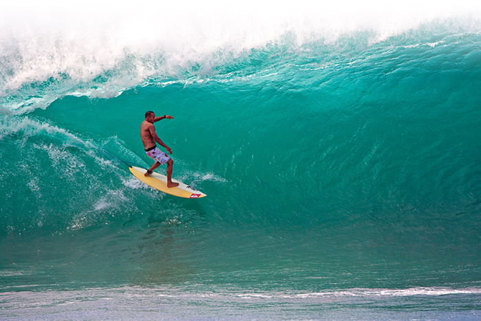 Men surfing in Hawaii
