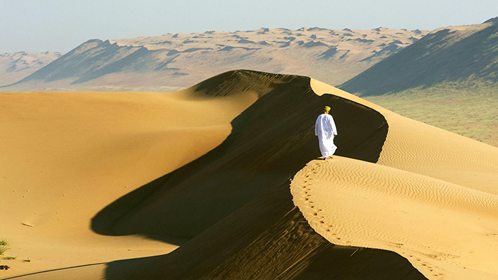 Man walking through a desert
