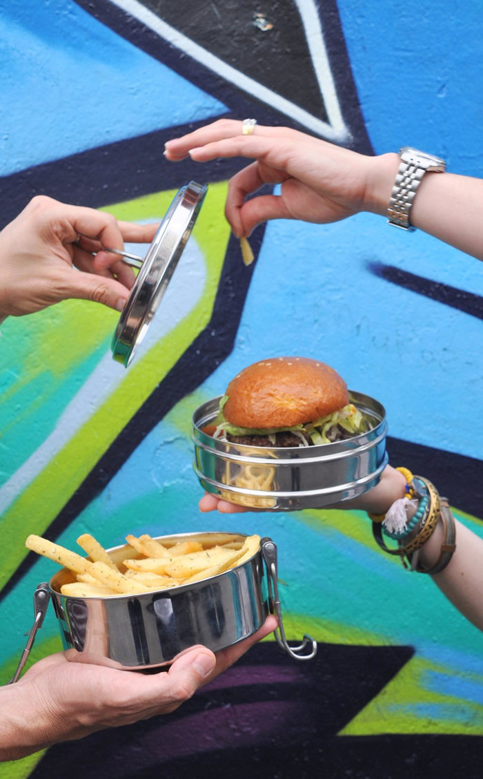 Zero waste food boxes with french fries and a sandwich