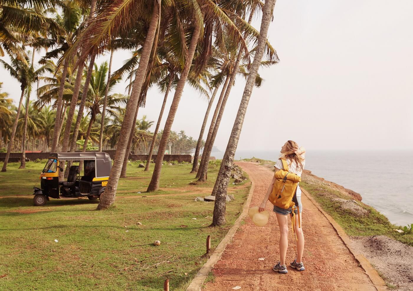 woman travelling with small yellow bagpack