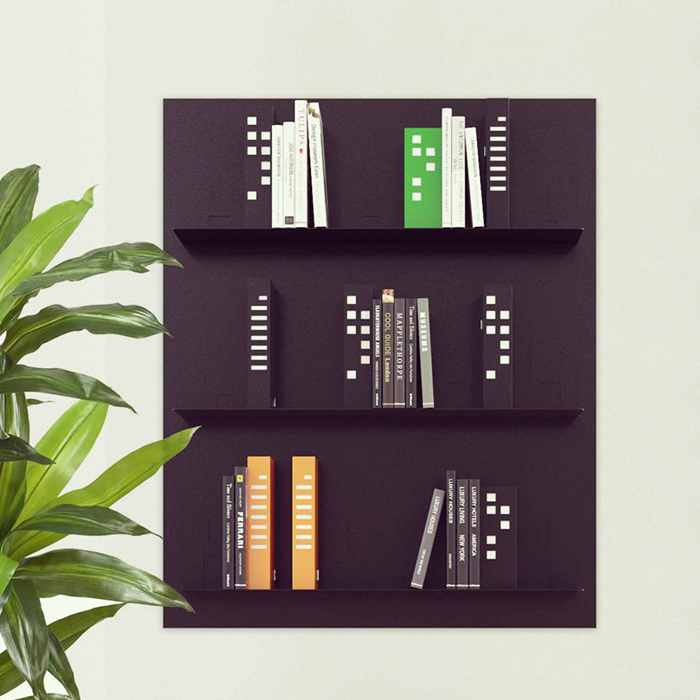 Bookshelf with a plant next to it