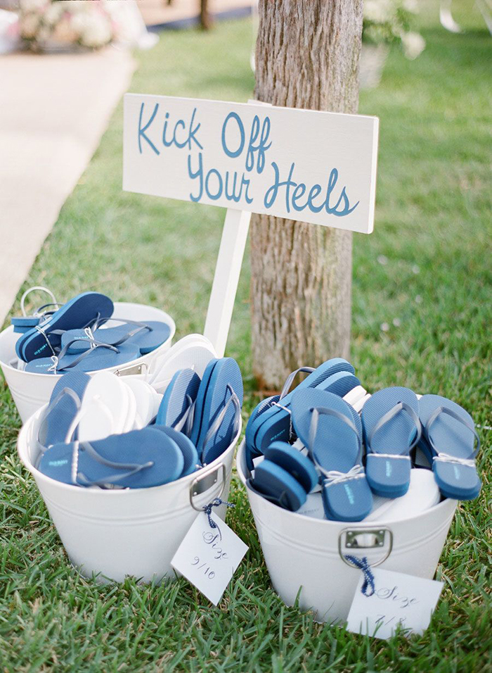 Flip flops and a sign saying Kick Off Your Heels