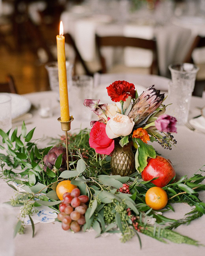 Fruits, flowers and a candle as wedding table decor