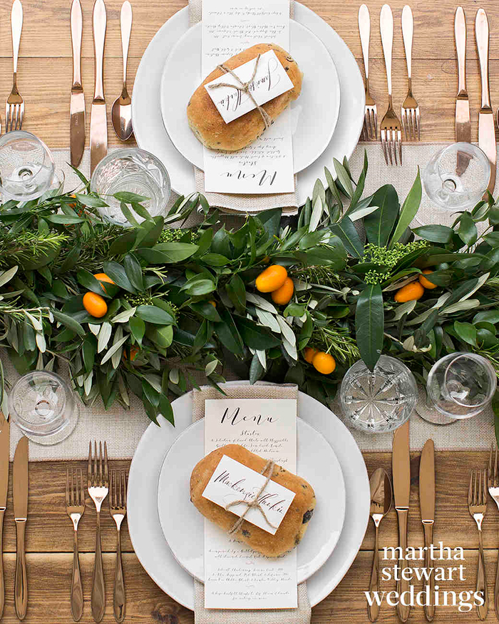 Two plates with bagels and nicely decorated wedding table with leaves
