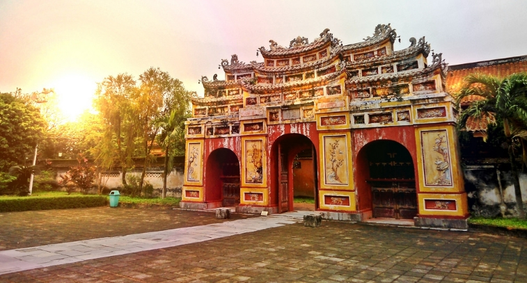 Imperial city of Hue with its ruins on a sunset