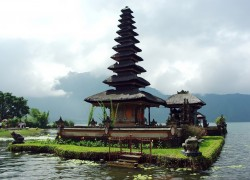 Typical house from Bali located in the sea and with a nice yard f grass around it