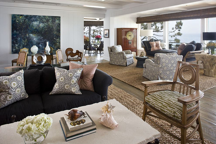 Huge living room decorated with nice natural rugs and cozy cushions on the sofas