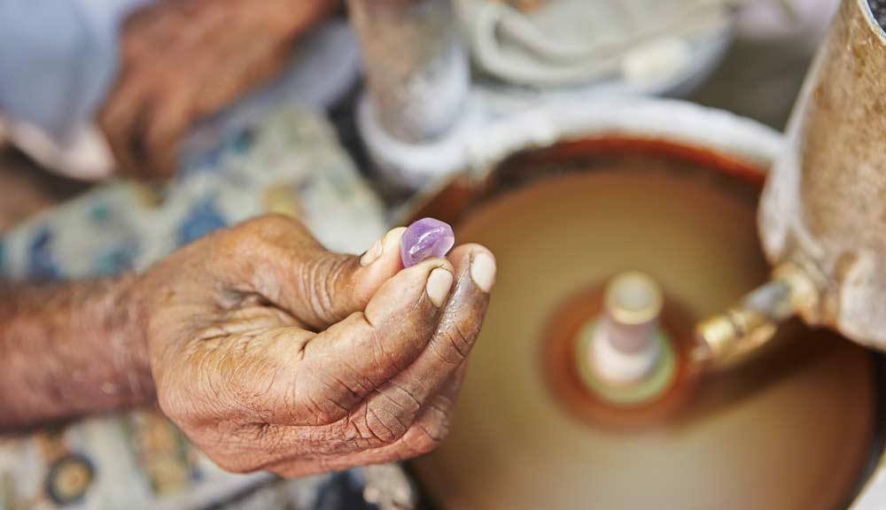 Elder person holding a jewelry from Sri Lanka