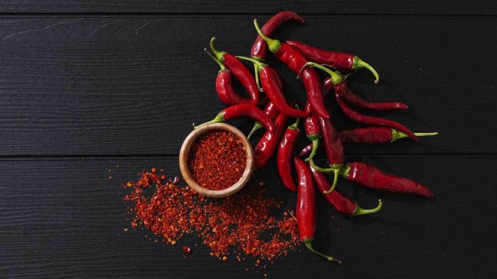 Powdered cayenne peppers and fresh peppers