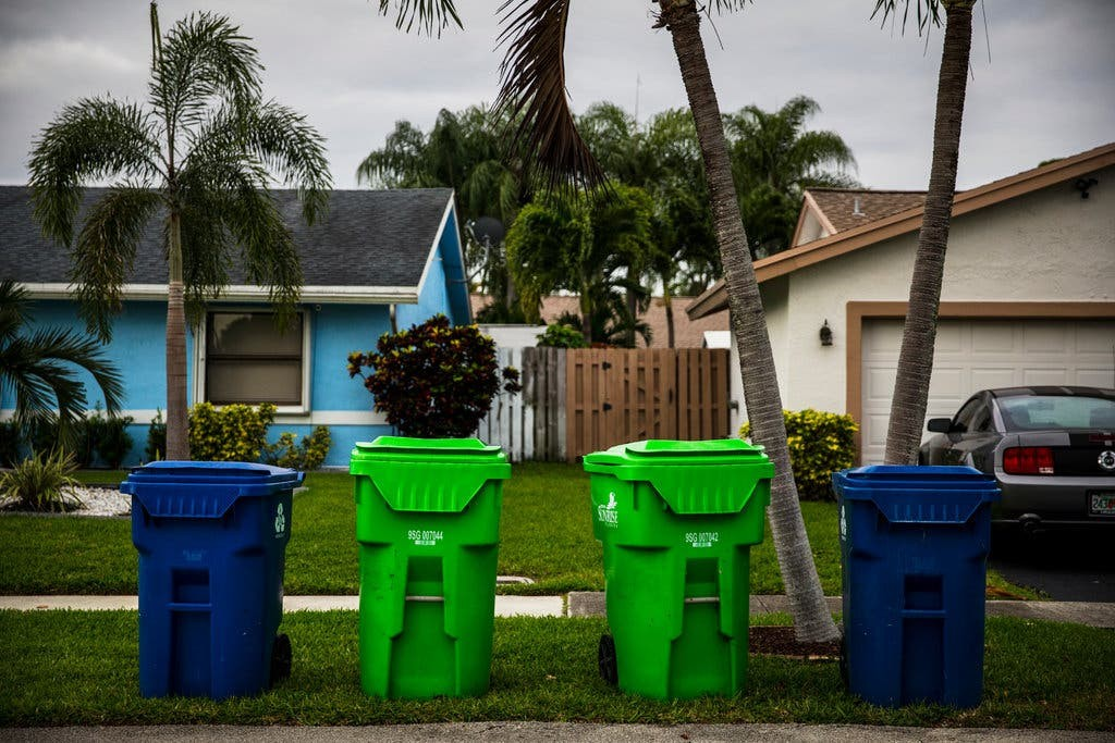 Recycling bins in front of a house