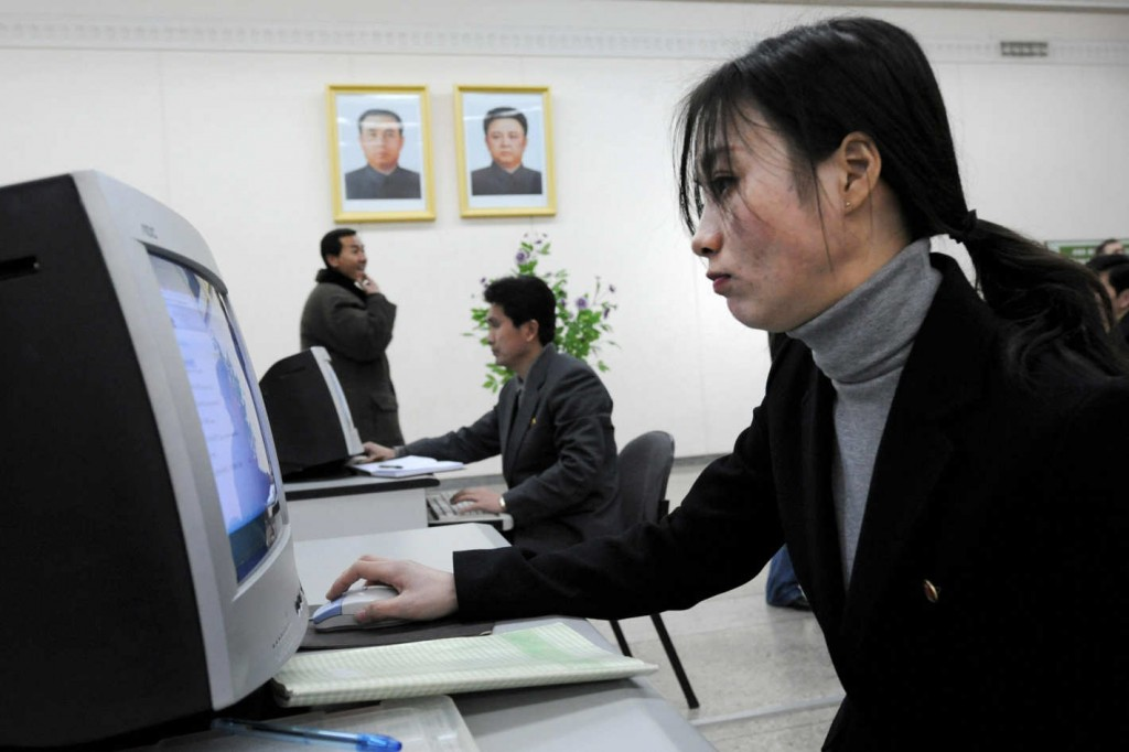 Woman and a man using computers in North Korea