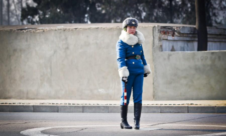 Young woman in North Korea guiding the traffic