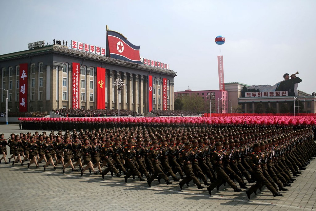 Big North Korean army with the flag behind