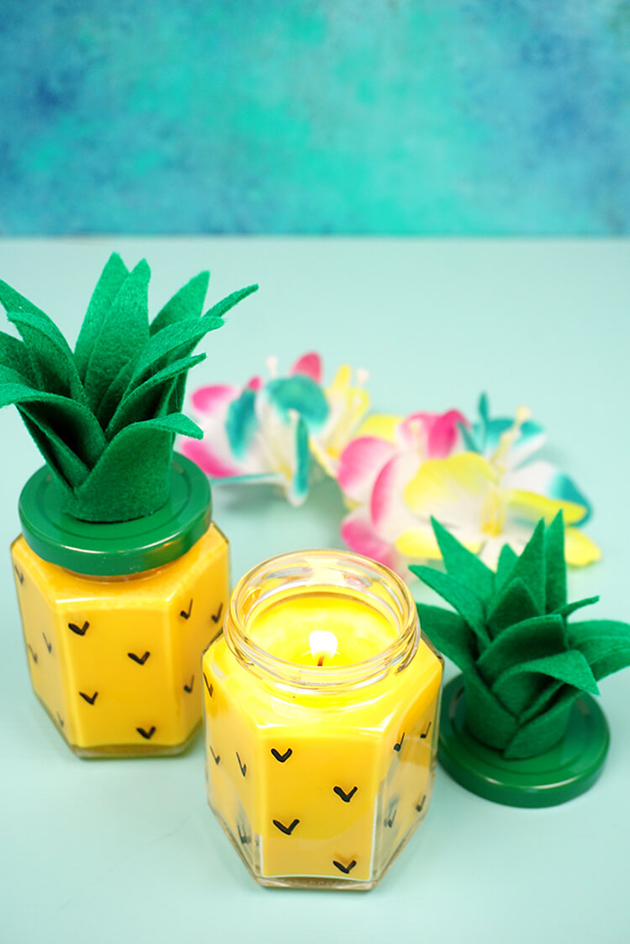 Candles in a pineapple themed jar