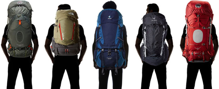 Men with different sizes of backpacks