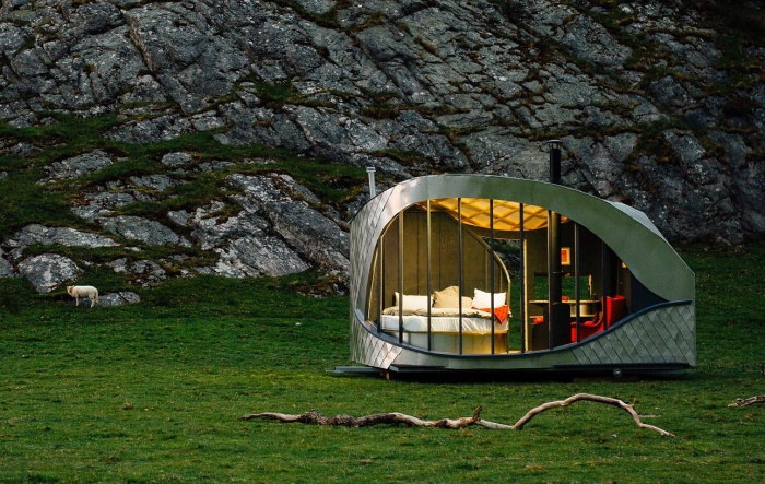 Luxury camping in a meadow with rocks behind