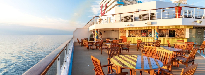 Cruise restaurant with wooden tables and chairs