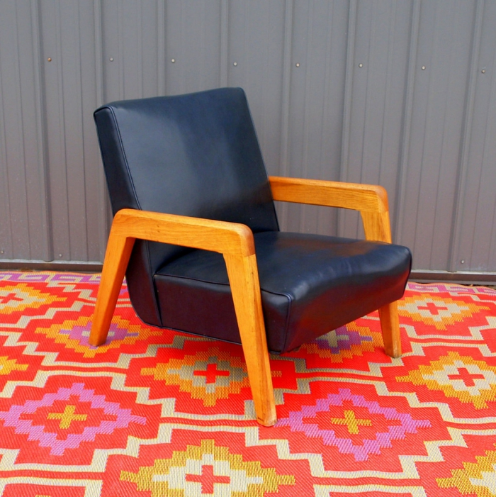 Leather reading chair on a carpet