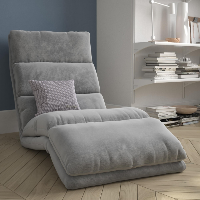 Short legs fabric reading chair with a bookshelf next to eat