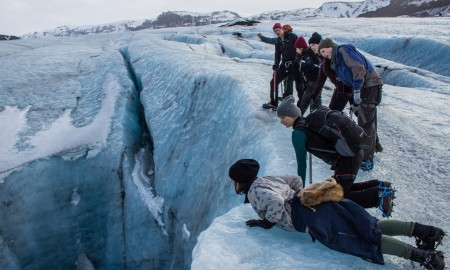 Group of tourists exploring Iceland