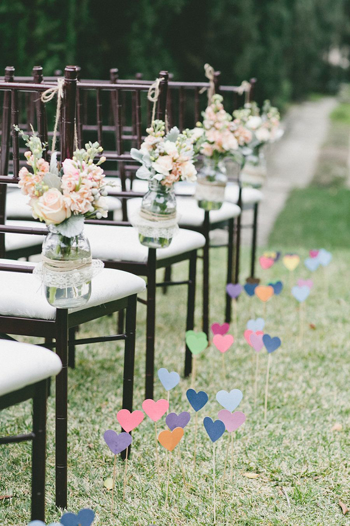 Flowers in a jar on every chair
