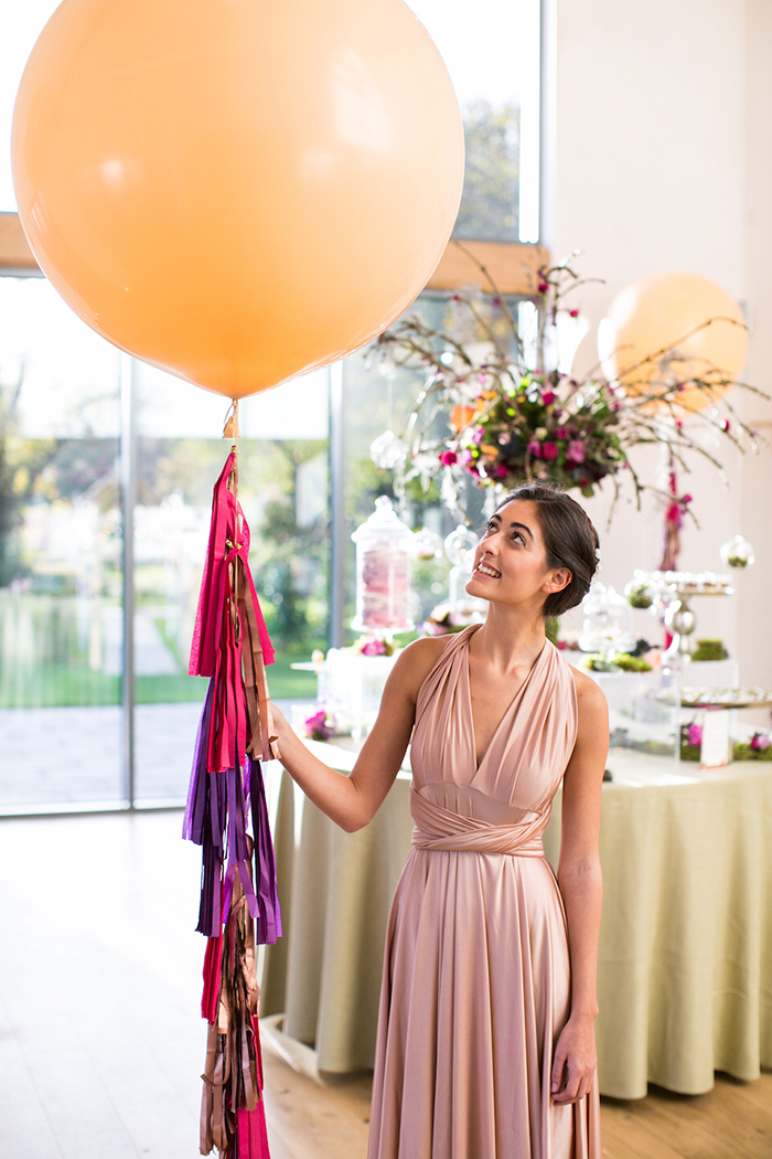 Woman in a dress holding a big balloon