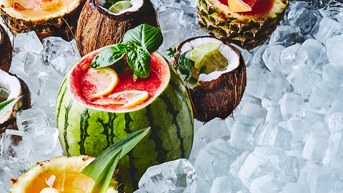 Hollowed out watermelons, coconuts and pineapples