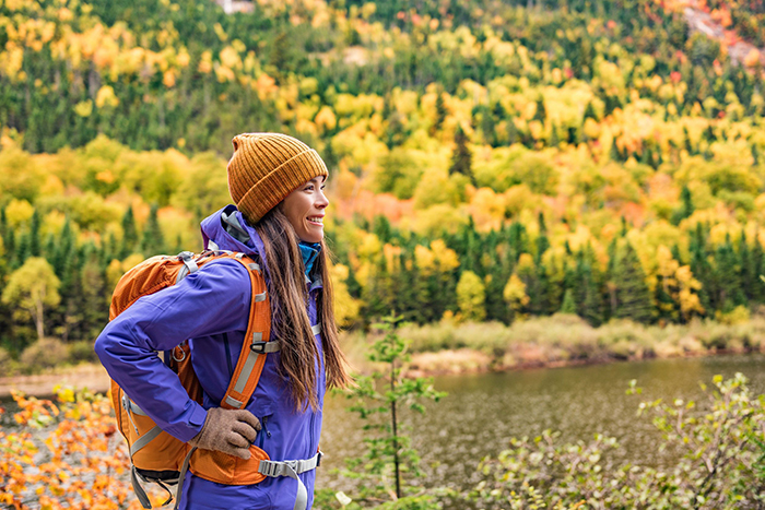 Woman hiking with a backpack on an autumn day