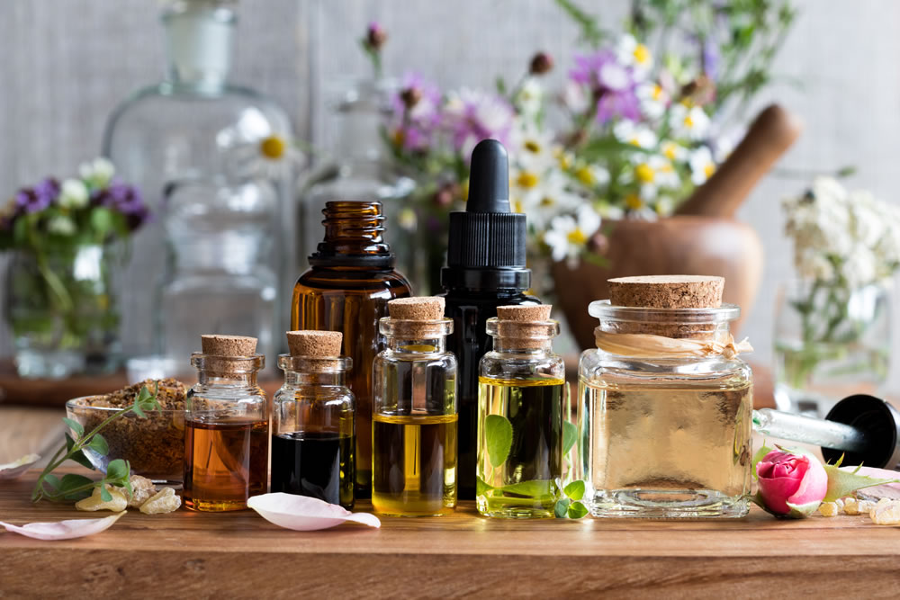Different kind of natural oils in small bottles