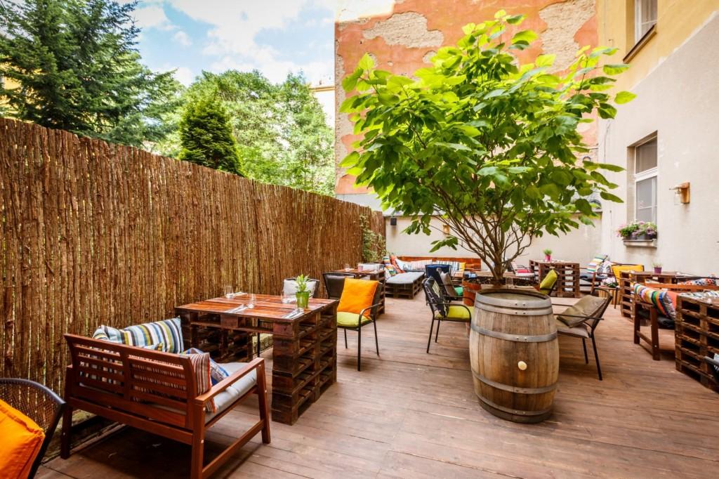 Outdoor vegan restaurant with wooden furniture
