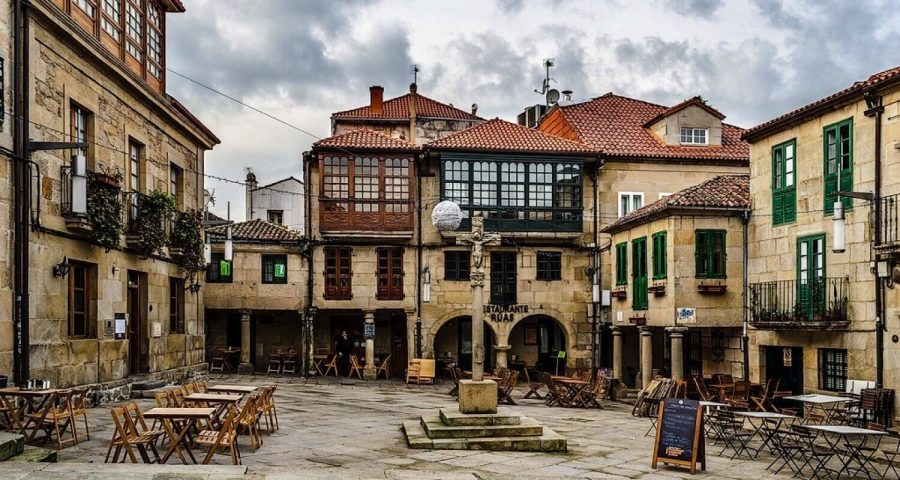 Square in Pontevedra with cute old buildings and bars in front of them