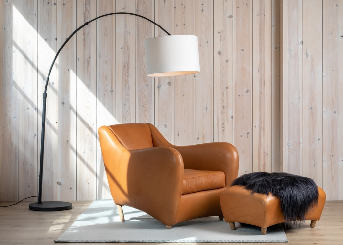 leather chair and a foot stool with a modern lamp