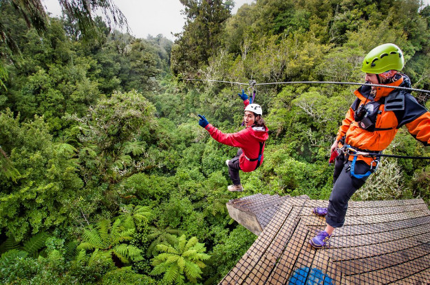 Couple trying ziplining in the jungle of Costa Rica