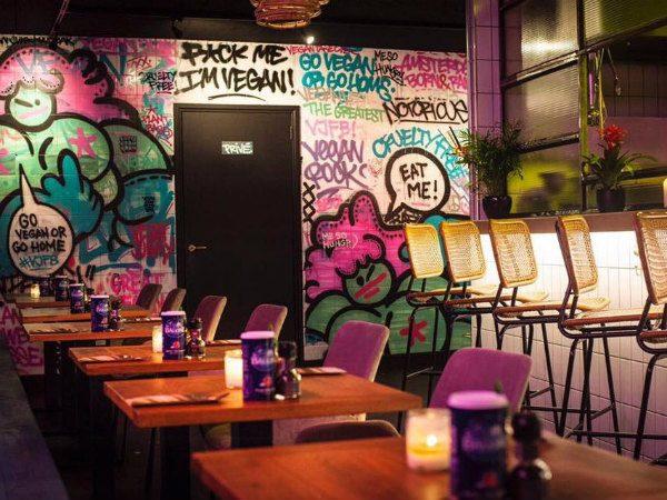 Interior of a vegan bar in Amsterdam full with graffiti