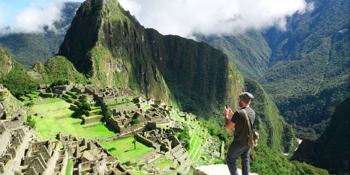 man taking a photo of the Matchu Pitchu