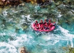 Men in a boat rafting in river