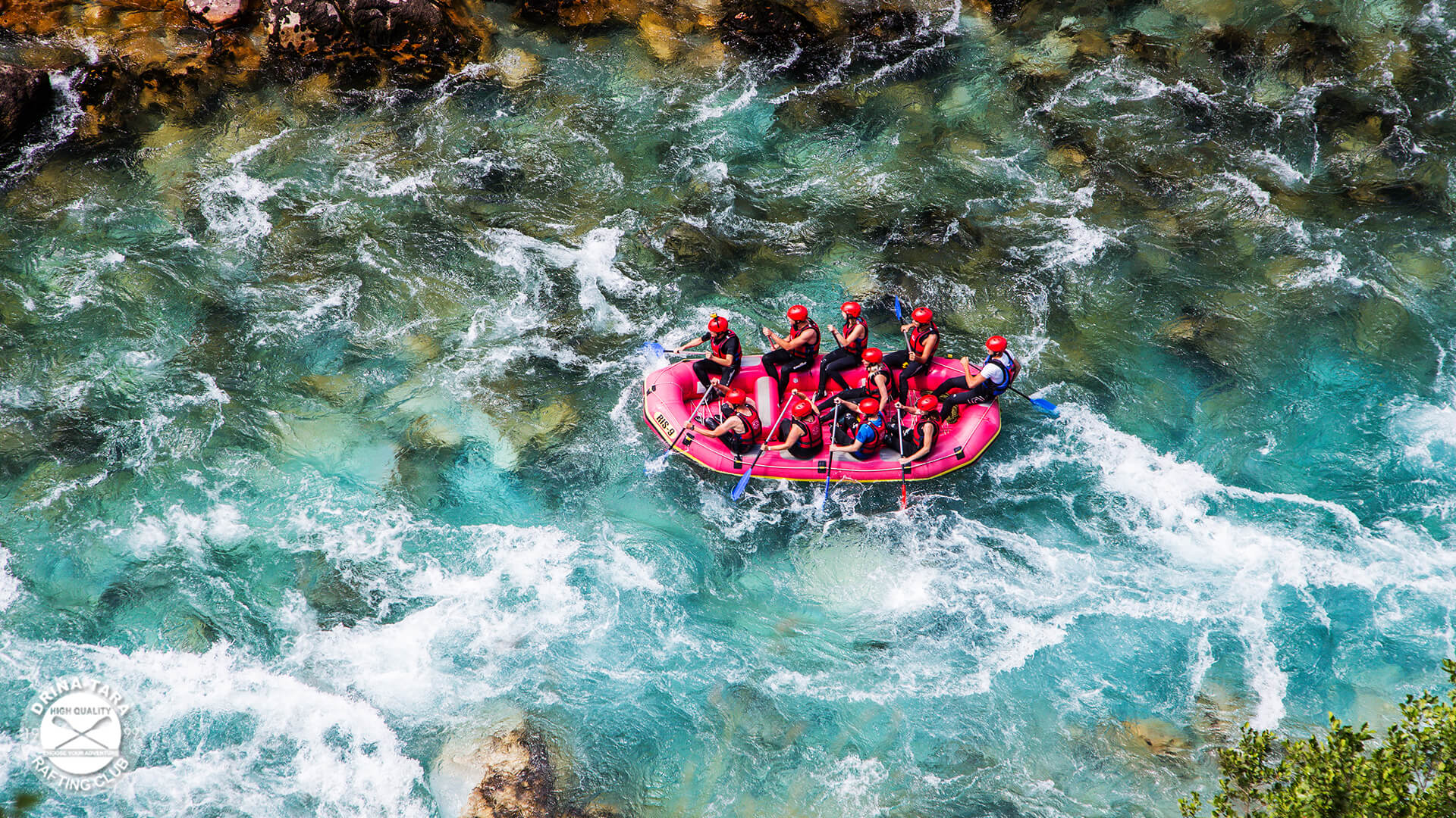 Men in a boat rafting in river