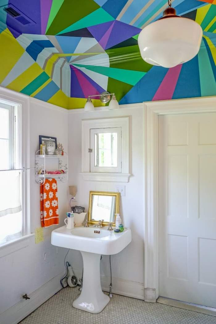 artistic colorful bathroom with painted ceiling